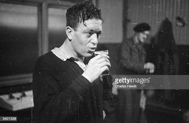 Rugby player F N Haigh of an Army team from New Zealand having a drink Original Publication Picture Post 3077 Kiwis In Action pub 1946
