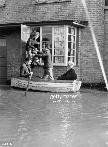 Residents of The Avenue Canvey Island Essex are evacuated from their home during the disastrous floods
