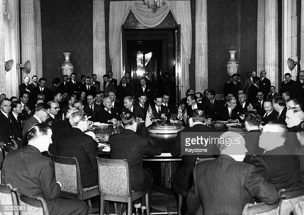 The delegates around at the Round Table at the Soviet Embassy in the Soviet Sector of Berlin for the opening of the second week of the Four Power...