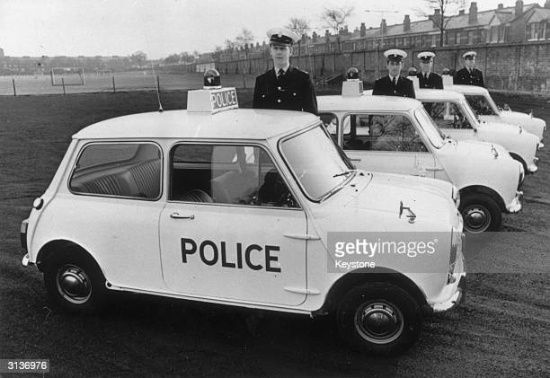Officers standing by four of the ten Mini Coopers which are a new addition to the Manchester city police force