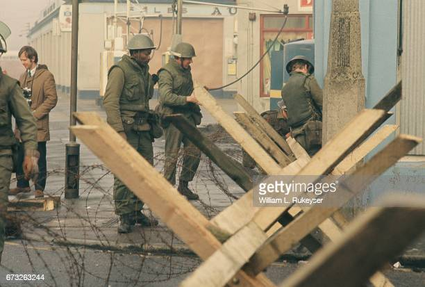 2nd February 1972 British soldiers at barbed wire barricade in Newry prior to a civilian protest organised in response to the shooting of 14...