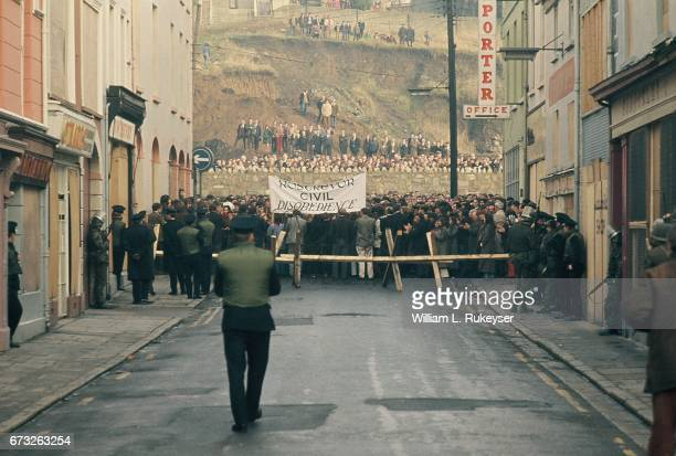 2nd February 1972 Civil rights marchers confront Royal Ulster Constabulary police and British soldiers at a barricade in Newry during a civilian...