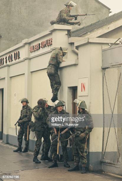 2nd February 1972 Soldiers take up positions in Newry prior to a civilian protest organised in response to the shooting of 14 civilians by British...