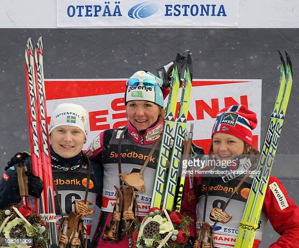 2nd Hanna Brodin of Sweden 1st Petra Majdic of Slovenia 3rd Maiken Caspersen Falla of Norway pose after the women's individual sprint Cross Country...