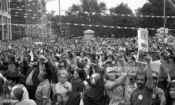 2nd Italian Unity Day Rally Columbus Circle demonstrators clasp hands aloft to signify unity as Unity Day rally continued following the shooting of...
