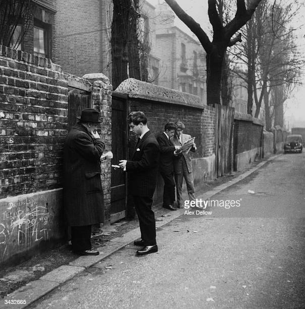 A pair of smartly dressed 'spivs' with time on their hands hang around on a London Street Original Publication Picture Post 6851 The Best And Worst...