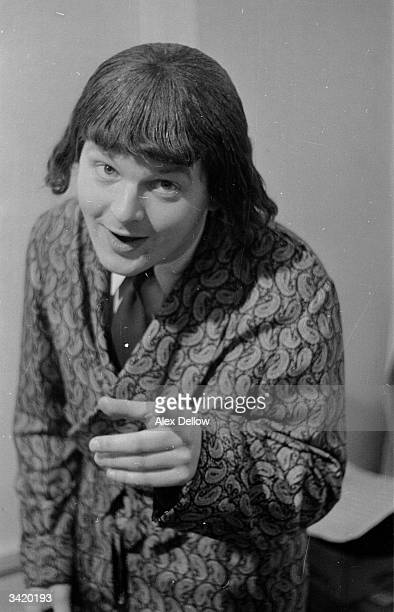 British comedian Benny Hill in character and wearing a wig Original Publication Picture Post 6849 The Queen's Champions pub 1954