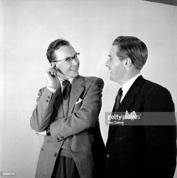 British comedians of stage and screen Eric Morecambe and Ernie Wise being photographed through a mirror Original Publication Picture Post 6849 The...