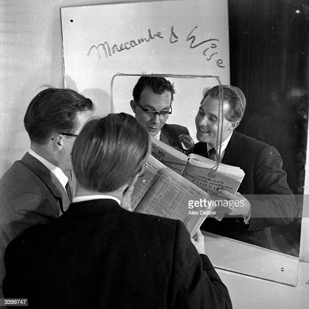 British comedians of stage and screen Eric Morecambe and Ernie Wise reading a newspaper Original Publication Picture Post 6849 The Queen's Champions...