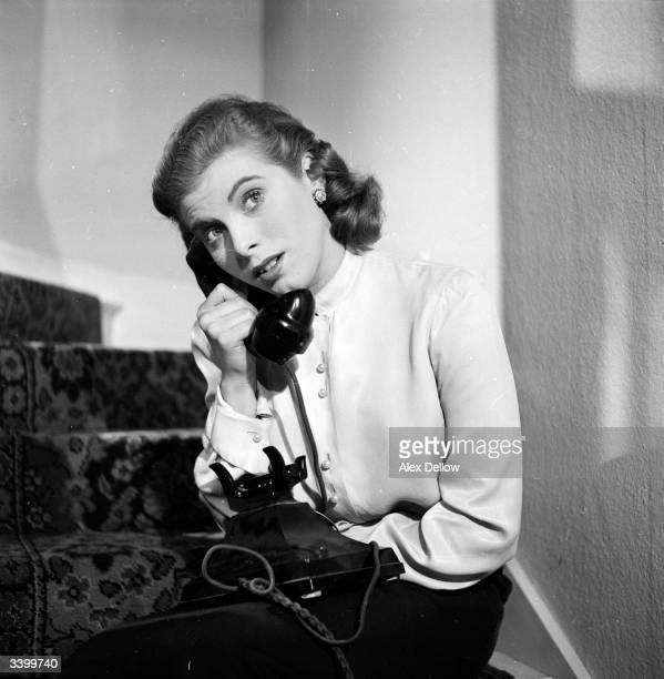 British stage and screen actress Billie Whitelaw on the telephone Original Publication Picture Post 6849 The Queen's Champions pub 1954