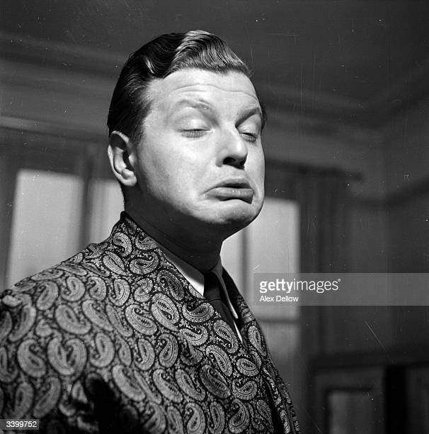 English comedian Benny Hill originally Alfred Hawthorne Hill pulling a face Original Publication Picture Post 6849 The Queen's Champions pub 1954