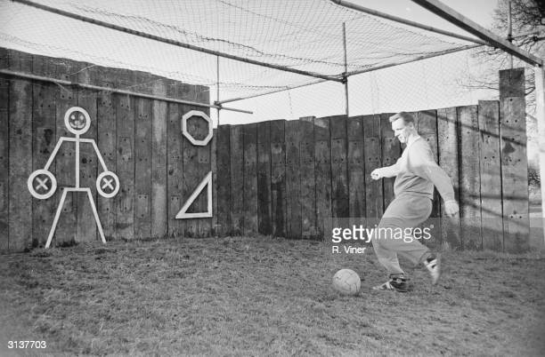 Birmingham City's Stan Lynn practices his shooting skills against tough opposition during a practice session