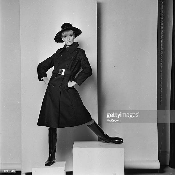 Vicky Hodge models a Lenore raincoat in the 'new' length, with a wide-brimmed hat and shiny knee-high boots.