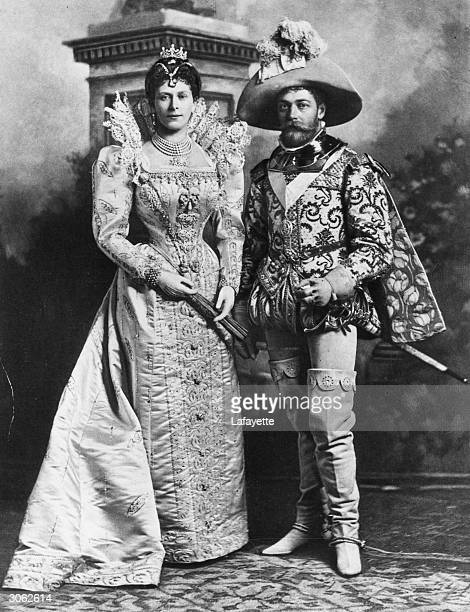 The Duke and Duchess of York later King George V and Queen Mary in costume as the 3rd Earl of Cumberland and a lady at the court of Marguerite de...