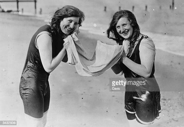 Holidaymakers share a towel on the beach at Lowestoft