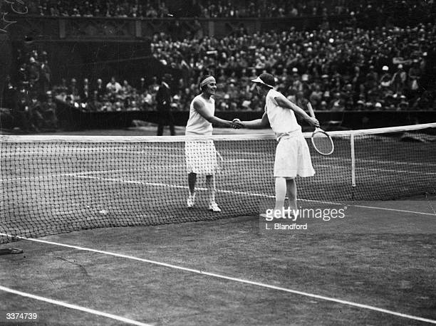 Lili de Alvarez of Spain congratulates Helen Wills of the USA after her victory in the women's singles final at the Wimbledon Lawn Tennis...