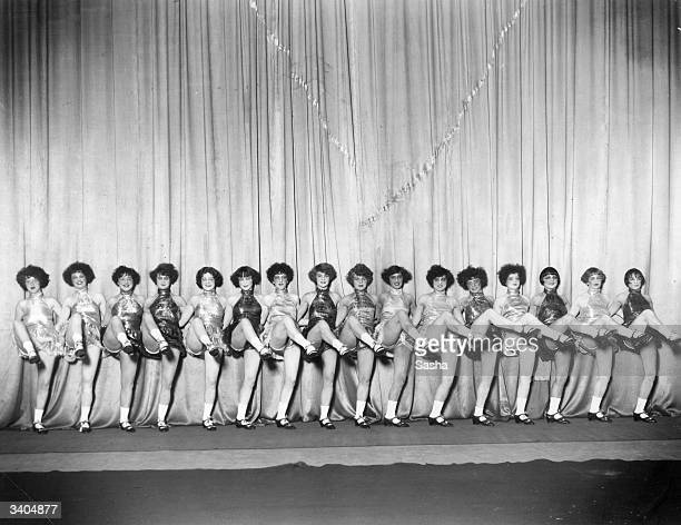 Alfred Jackson's Dancing Girls perform their high kicks on the stage at the Alhambra