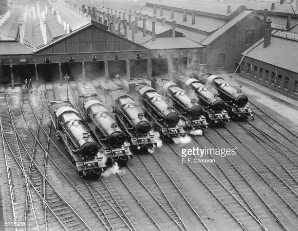 The new King class of engines in the GWR line leaving the running sheds at Swindon