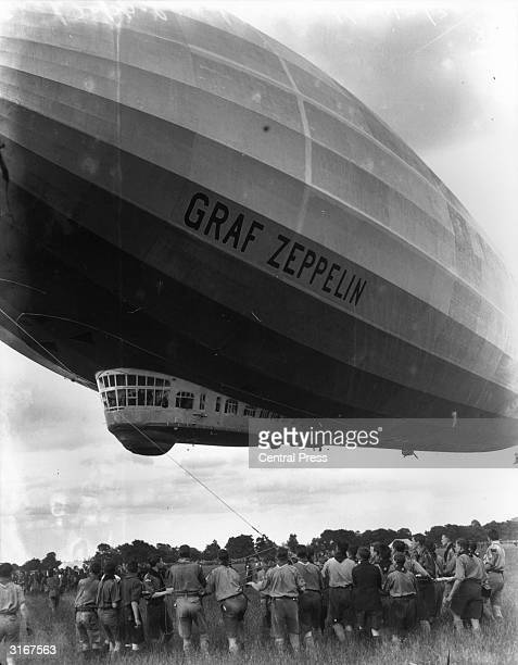 The Graf Zeppelin is guided to its mooring by British boy scouts at Hanworth Middlesex