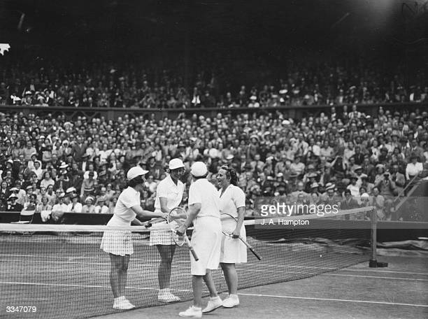 Sarah Fabyan and Alice Marble shake hands with Simone Mathieu and Billie Yorke after beating them in the Women's Doubles Finals at the Wimbledon Lawn...