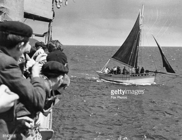 A small fishing boat with a party of British Soldiers oversees the evacuation of Brest the French Naval base in Brittany during World War II