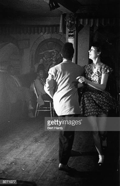 British couple, from different ethnic backgrounds, dancing. Original Publication: Picture Post - 4825 - Is There A British Colour Bar - pub. 1949