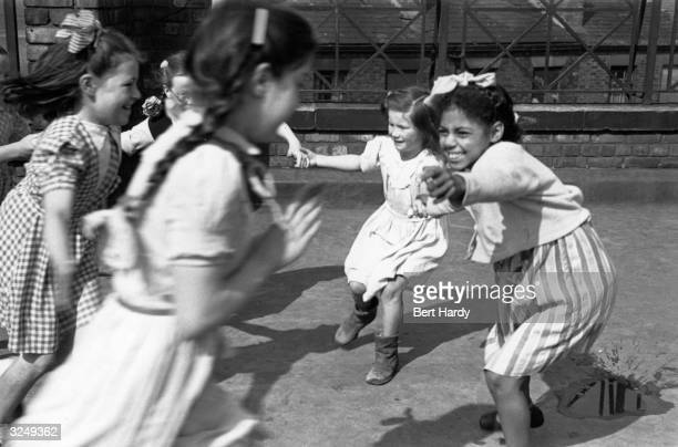 Children playing tag during morning break at Windsor Street County School in Liverpool Original Publication Picture Post 4825 Is There A British...