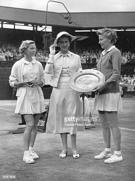 Marina Duchess of Kent born Princess Marina of Greece and Denmark presents the Wimbledon women's singles trophy to Louise Brough of the USA after he...