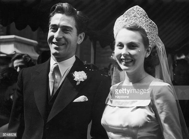 Irish actor Dermot Walsh with film actress Hazel Court after their wedding at St James' Spanish Place London