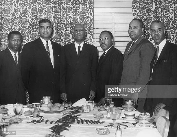 LR National civil rights leaders John Lewis Whitney Young Jr A Philip Randolph Dr Martin Luther King Jr James Farmer and Roy Wilkins pose behind a...
