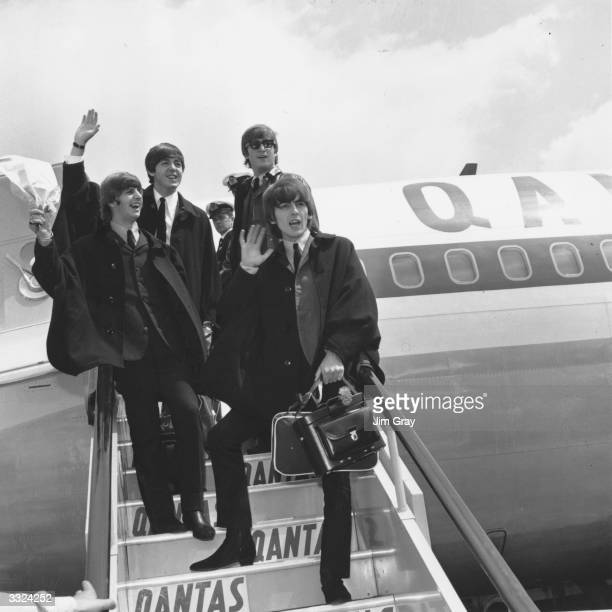 British pop group The Beatles Ringo Starr Paul McCartney John Lennon and George Harrison wave to the 200 fans who have turned up to greet them at...
