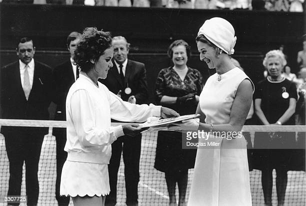 Princess Alexandra presents the trophy to Evonne Goolagong of Australia after she beat Margaret Court to win the women's singles title at Wimbledon