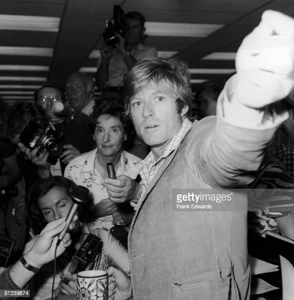 2nd July 1975 American actor Robert Redford speaks to the press on the set of the film 'All The President's Men' directed by Alan J Pakula July 2 1975