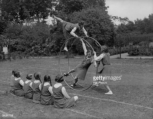 Crouch End High School girls using an exercise wheel in an open air gym lesson