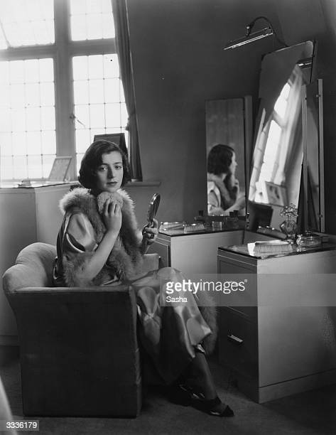 Actress Phyllis Konstam wife of tennis player Bunny Austin at her dressing table