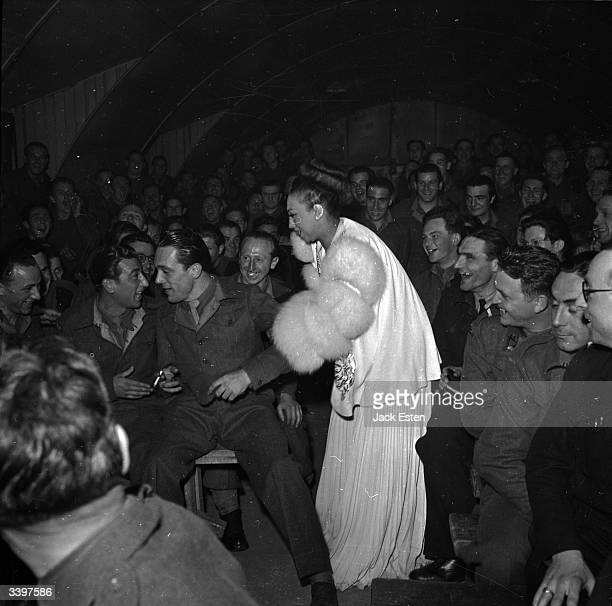 American dancer and singer Josephine Baker selecting a reluctant soldier for a dance during a victory party in London Original Publication Picture...