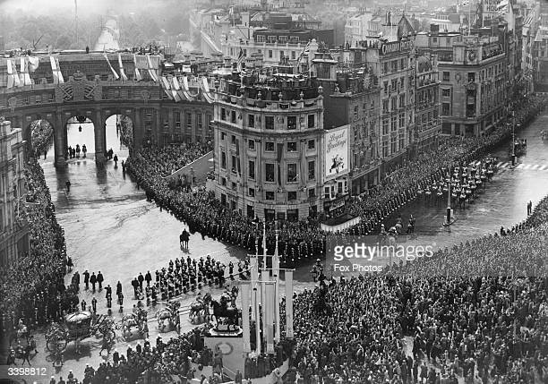 Crowds lined around Pall Mall and Trafalgar Square central London watching Queen Elizabeth II as she tours the city after her Coronation at...