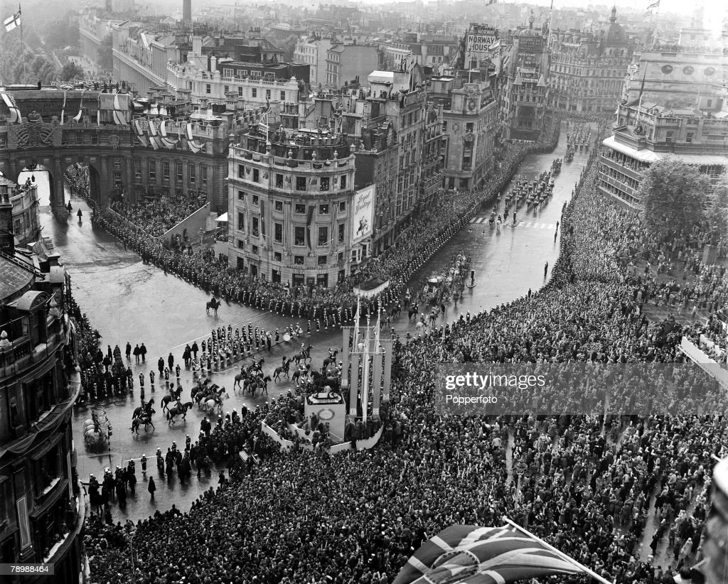2nd June 1953. London, England. The Coronation of Queen Elizabeth II. The Coronation Procession of Queen Elizabeth II winds its way through the crowds of well-wishers congregated at Trafalgar Square, as the State Coach passes down Cockspur Street. : News Photo