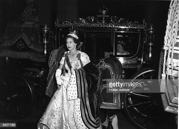 Princess Margaret Rose getting out of a state coach after attending the coronation of her sister Queen Elizabeth II Queen Elizabeth The Queen Mother...