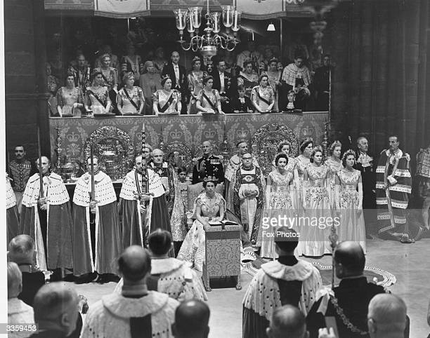 Queen Elizabeth II amongst dignitaries and ladiesinwaiting during her Coronation ceremony in Westminster Abbey London