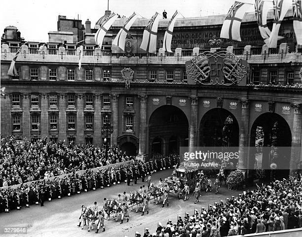 Queen Elizabeth II Coronation carriage and procession coming through Admiralty Arch on the way from Westminster Abbey to Buckingham Palace