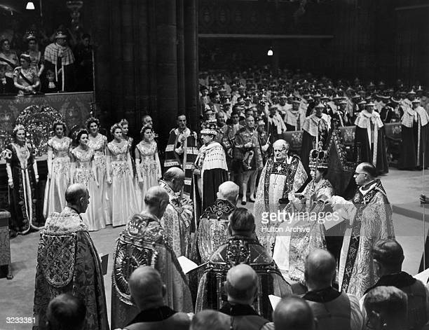 Queen Elizabeth II holds the Rod with Dove in her left hand and the Sceptre with Cross in her right hand, shortly after being crowned in Westminster...