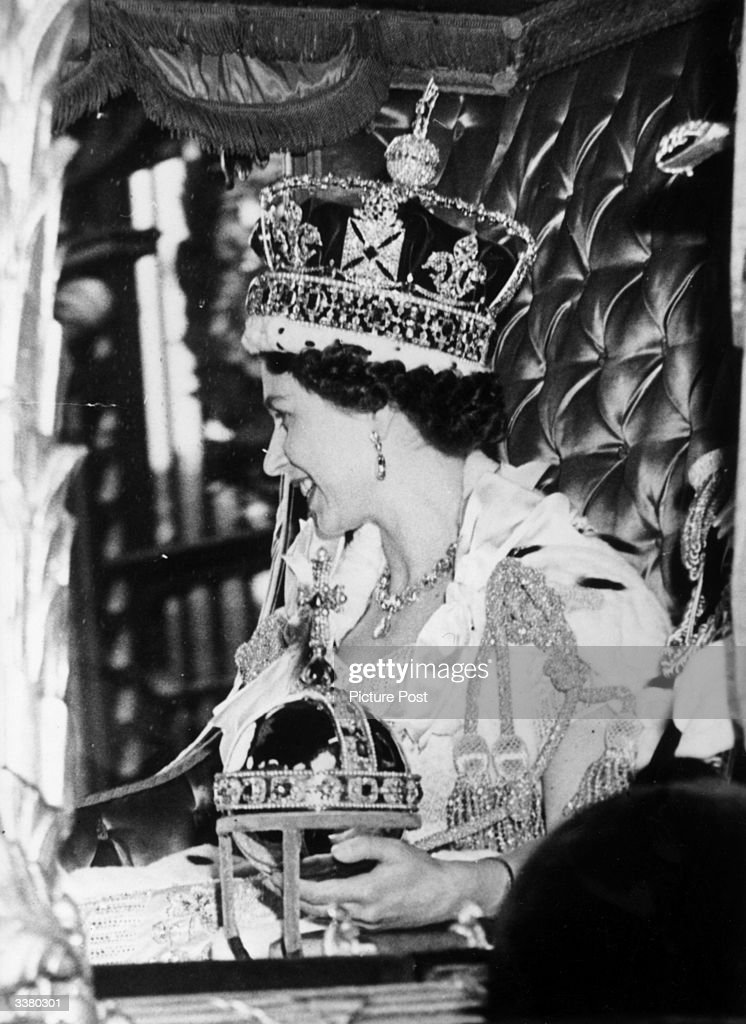 Queen Elizabeth II wearing the State Crown and carrying the State orb in a Royal carriage after her Coronation ceremony. Original Publication: Picture Post - 6537 - The Coronation Of Queen Elizabeth - pub. 1953
