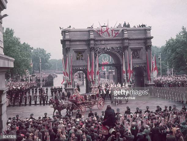Queen Elizabeth II's coronation procession passes through Marble Arch in London