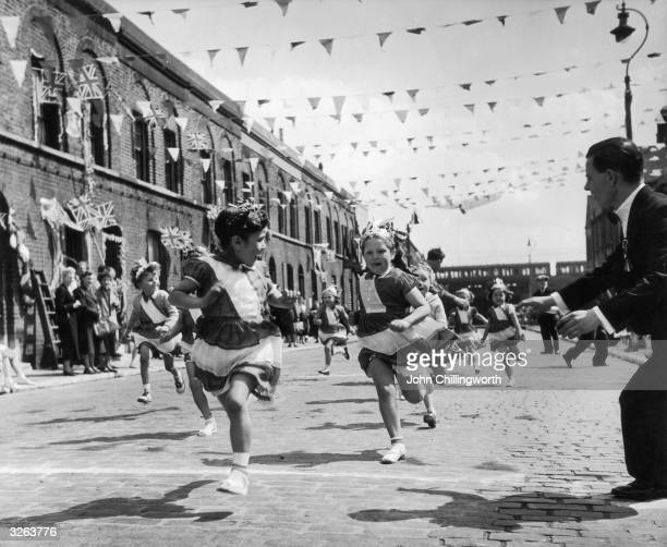 The children of Morpeth Street in London's East End enjoying a street party in celebration of the Coronation of Queen Elizabeth II Original...