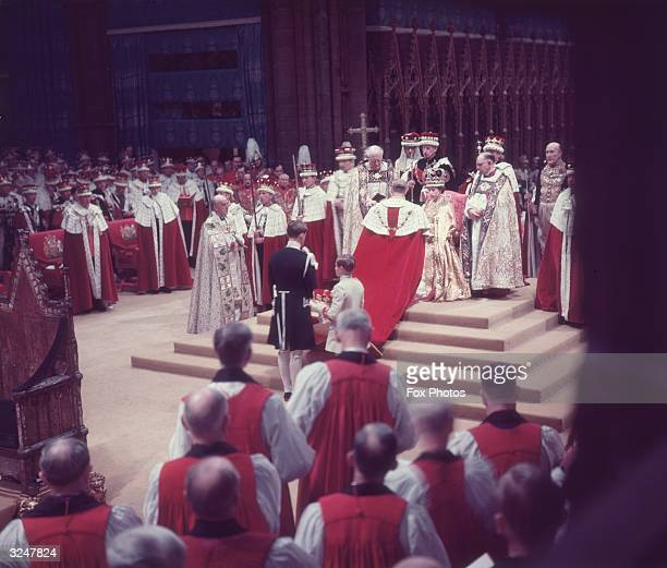 The Duke of Edinburgh pays homage to his wife, the newly crowned Queen Elizabeth II, during her coronation ceremony.