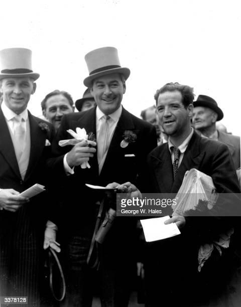 American film actor Errol Flynn attending the Derby horse race at Epsom Downs in Surrey.