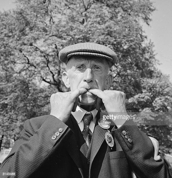 Farmer David Murray puts his fingers in his mouth and whistles during the Daily Express sheepdog trials in London's Hyde Park
