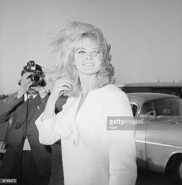 Mandy RiceDavies a Welsh showgirl and witness in the Profumo affair arrives at London Airport