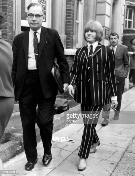 25 year old Brian Jones guitarist with British pop group the Rolling Stones smiles as he leaves West London Court where he appeared with Prince...